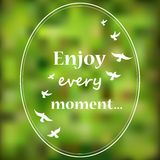 Enjoy every moment phrase on blur background Royalty Free Stock Photo