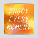 Enjoy every moment. Typography on beautiful Abstract Orange Tria. Ngular Polygonal background Royalty Free Stock Photo