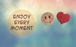 Enjoy every moment with heart and smile emoji royalty free stock images