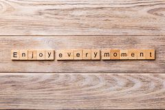 Enjoy Every Moment word written on wood block. Enjoy Every Moment text on wooden table for your desing, concept royalty free stock images