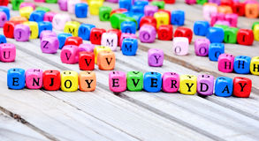 Enjoy everyday words on table Royalty Free Stock Photography