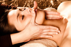 Enjoy in face massage Stock Image