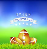 Football American balls on green field  Stock Photography