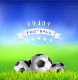 Football  soccer  balls on green field. Sport background Royalty Free Stock Images