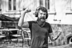 Enjoy free songs everyday. Excellent music in his playlist. Man bearded hipster with headphones listening music. Hipster. Enjoy high quality sound of song in stock photography
