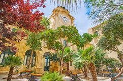 Enjoy the garden in Courtyard of Grandmaster`s Palace, Valletta,. VALLETTA, MALTA - JUNE 17, 2018: The joyful shady garden in Prince Alfred`s Courtyard of Royalty Free Stock Photos