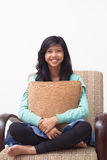 Isolated happy teenager smiling to the camera and holding her pillow at home Royalty Free Stock Image