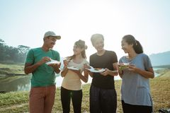 Enjoy happy breakfast in side lake royalty free stock image