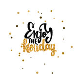 Enjoy the holiday Calligraphy gold paint, similar to the foil . Handmade vector  for your design. Enjoy the holiday -lettering text . Badge drawn by hand, using Stock Photos