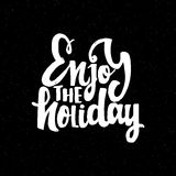Enjoy the holiday - hand-lettering text . Handmade vector calligraphy for your design. Enjoy the holiday -lettering text . Badge drawn by hand, using the skills Royalty Free Stock Photography