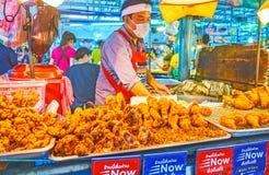 Enjoy the hot deep fried chicken, Talad Saphan Phut market, Bangkok, Thailand