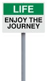 Enjoy the Journey. A conceptual sign on Life Royalty Free Stock Images