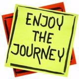Enjoy the journey on sticky note Stock Photography