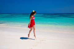Enjoy life. Beautiful girl jumping running on exotic beach with. White sand and blue water. Happiness bliss freedom seashore concept. Enjoyment. Vacation Stock Images