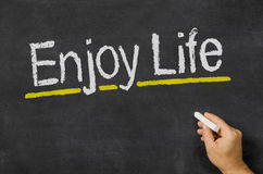 Enjoy Life. Blackboard with the text Enjoy Life Royalty Free Stock Images
