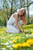 Enjoy life - happy young teen. Enjoying life - happy young teen person outdoors on blooming grassfield Royalty Free Stock Photos