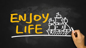 Enjoy life and sailing boat hand drawing on blackboard Stock Image