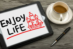 Enjoy life and sailing boat hand drawing on tablet pc Stock Photo