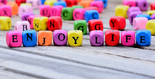 Enjoy life words on table Royalty Free Stock Photos