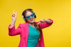 Free Enjoy Listening To Music. Young Redhead Woman In Headphones Listening Music. Funny Smiling Girl In Earphones And Pink Royalty Free Stock Photography - 173622427