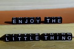 Enjoy the little thing on wooden blocks. Motivation and inspiration concept. Cross processed image royalty free stock image