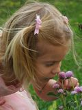 Enjoy The Little Things. Children photography ... Little girl outside enjoying the flowers Royalty Free Stock Photos