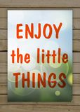 Enjoy The Little Things Enjoy on the natural blurry background. Typography on beautiful colorful background with bokeh Royalty Free Stock Photos