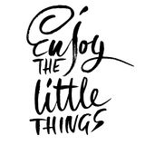Enjoy the little things. Hand drawn dry brush lettering. Ink illustration. Modern calligraphy phrase. Vector Stock Images
