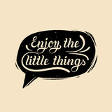 Enjoy the little things hand lettering motivational quote in speech bubble. Vector typographic inspirational poster. Enjoy the little things hand lettering Royalty Free Stock Photography