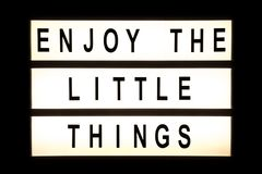 Enjoy the little things hanging light box. Sign board stock illustration