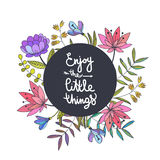 Enjoy the little things lettering. Floral background with beauti Stock Images
