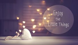 Enjoy The Little Things message with a white heart. With heart shaped lights Stock Image