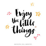Enjoy the little things. Modern brush calligraphy. Lettering. Enjoy the little things. Modern brush calligraphy. Handwritten ink lettering. Hand drawn design Stock Photos
