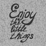 Enjoy the little things. Motivational quote - Enjoy the little things. Vector illustration. Perfect for poster, card, smartphone case and textile. Grey hand Royalty Free Stock Image
