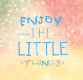 Enjoy The Little Things Quote Typographical. Over colorful bokeh lights background Royalty Free Stock Photos