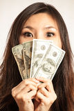 Enjoy making some money. Asian woman making some money stock photography