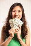 Enjoy making some money. Happy Asian woman making some money Stock Photo