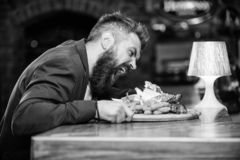 Enjoy meal. Cheat meal concept. Hipster hungry eat pub fried food. Manager formal suit sit at bar counter. Delicious. Meal. Man received meal with fried potato stock images