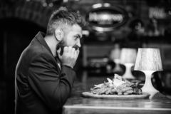 Enjoy meal. High calorie snack. Cheat meal concept. Hipster hungry eat pub fried food. Manager formal suit sit at bar. Counter. Delicious meal. Man received stock photos