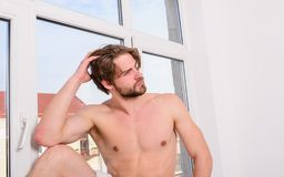 Enjoy morning welcome new awesome day. Macho guy relaxing near window bedroom. Macho relaxing in morning bedroom. Feel divine concept. Man nude attractive royalty free stock photo
