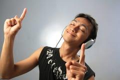 Enjoy music. Portrait man enjoy music smiling Royalty Free Stock Images