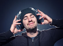 Enjoy the music. Caucasian man wera cap and headphone feel the music Stock Images