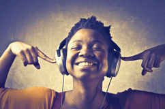 Enjoy music. Smiling african woman listening to music stock photos