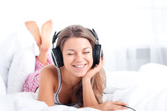 Enjoy music!. Bedtime collection: listening music on bed Royalty Free Stock Image