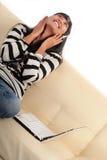Enjoy music. Woman enjoy music on sofa Royalty Free Stock Photography
