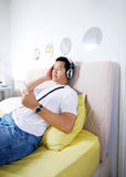 Enjoy the music on bed Stock Photo
