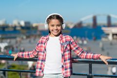 Enjoy music everywhere. Best music apps that deserve a listen. Girl child listen music outdoors with modern headphones. Make your kid happy with best rated royalty free stock photos