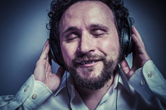 Enjoy the music, man with intense expression, white shirt Royalty Free Stock Photography