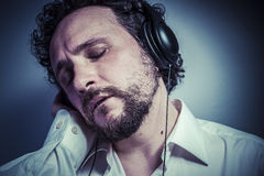 Enjoy the music, man with intense expression, white shirt Royalty Free Stock Images