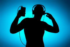Enjoy music, silhouette on blue Royalty Free Stock Images